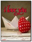 Paper boat and red heart