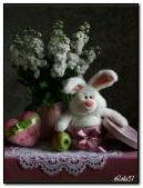 The white rabbit with a bouquet of flowe