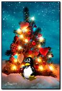 Noel ağacının etrafında penguen