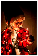 Boy Santa Tangled In Lighted Garlands