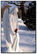 Angel Statue At Snow