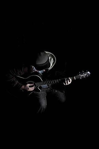 Dark Guitar Player
